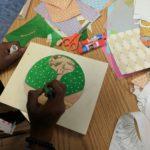 Child creates circular collage