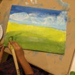 Child painting a landscape